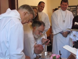 A baptism before Sunday service at St. Andrew's Anglican Church